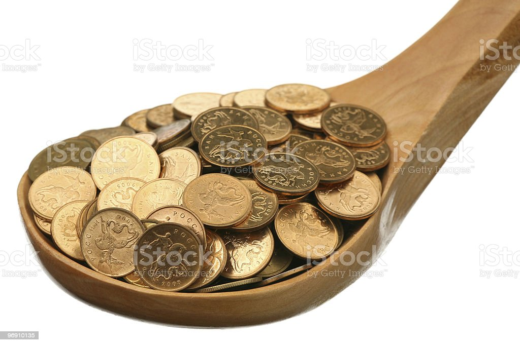 Russian coins in a wooden spoon royalty-free stock photo