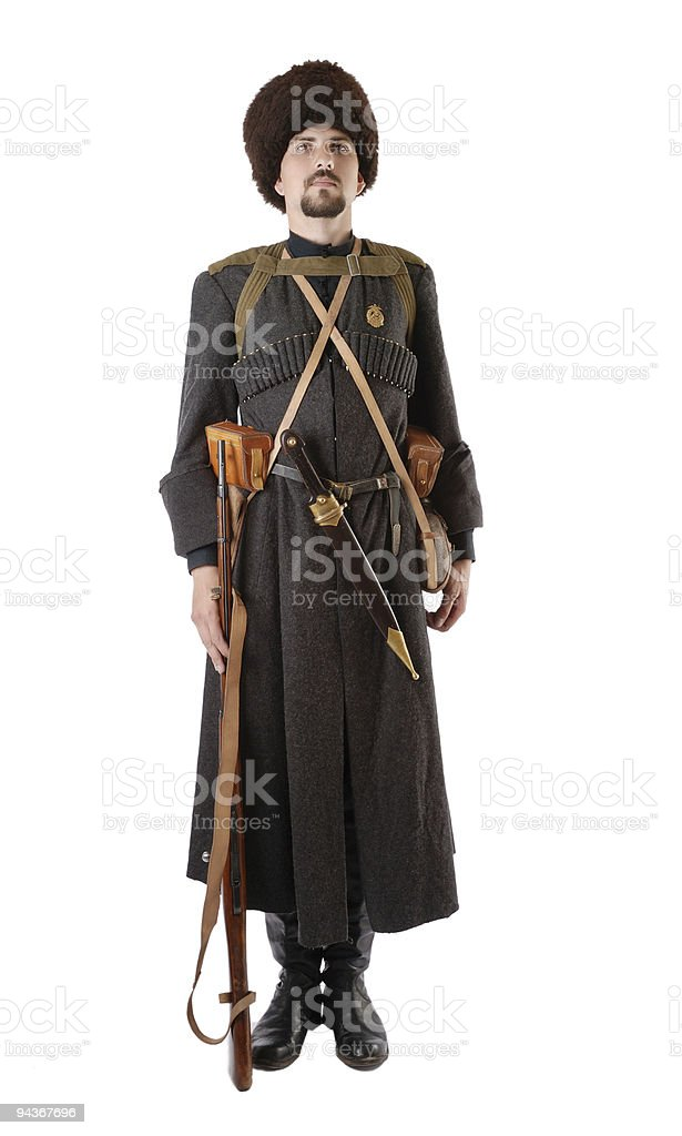 Russian Cossack standing at attention. The living history. stock photo