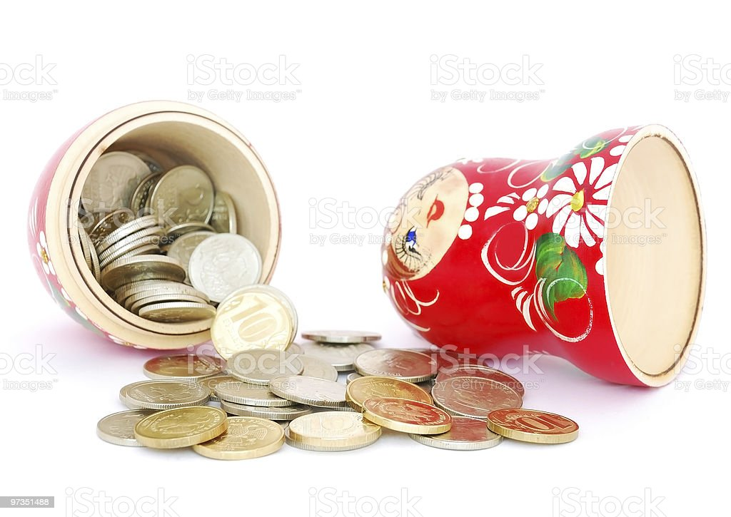 Russian doll with coins stock photo
