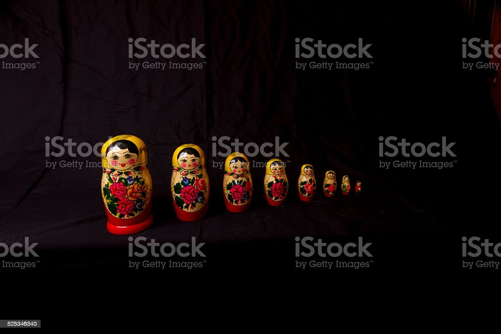 Russian Dolls matryoshka in low light royalty-free stock photo