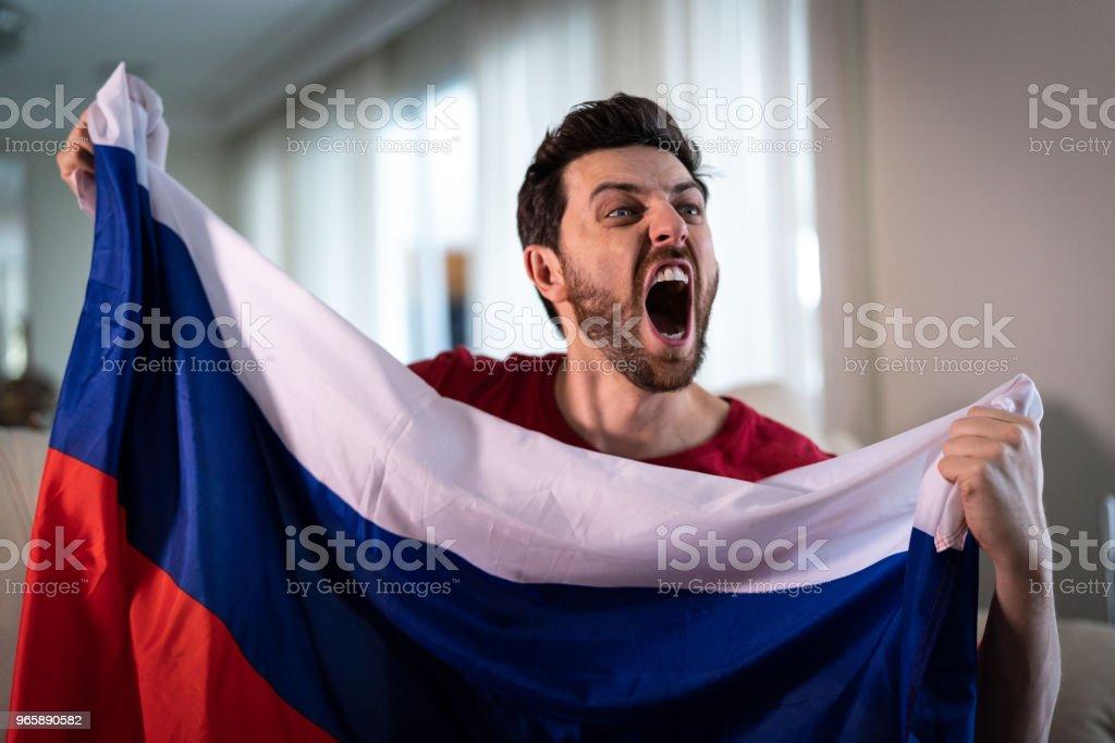 Russische fan vieren thuis - Royalty-free Alleen mannen Stockfoto