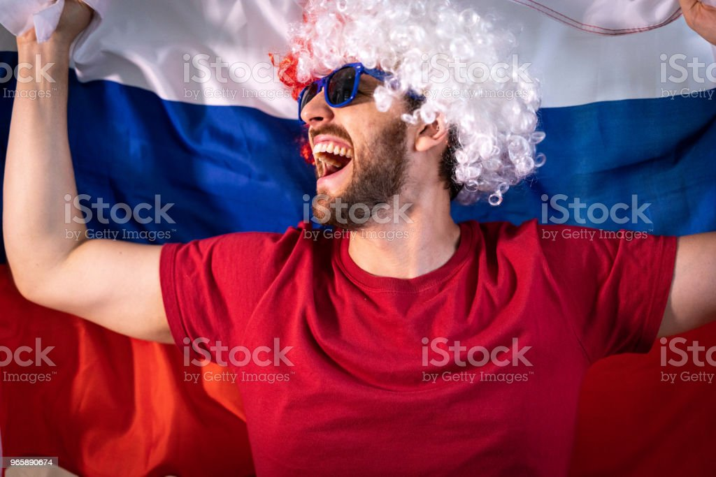 Russian fan celebrating at home - Royalty-free Adult Stock Photo