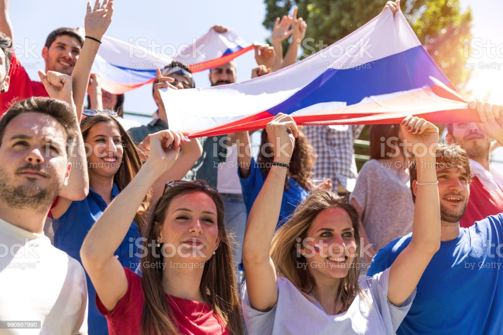 Russian fans watching and supporting their team at world competition football league stock photo