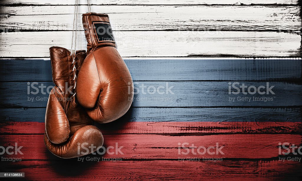 Russian flag and boxing gloves stock photo