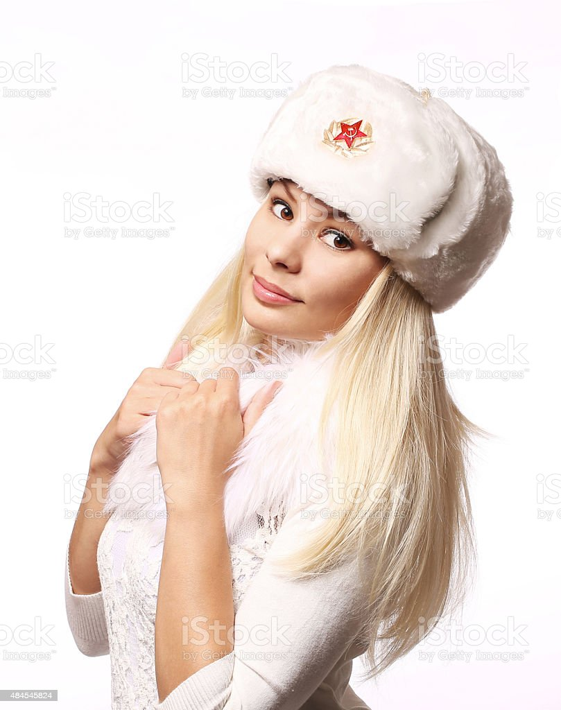 Russian girl wearing military hat isolated. Young beautiful blond woman stock photo