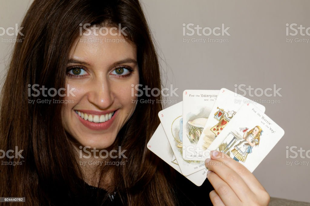 Russian indoor girl with Alice In Wonderland playing card stock photo
