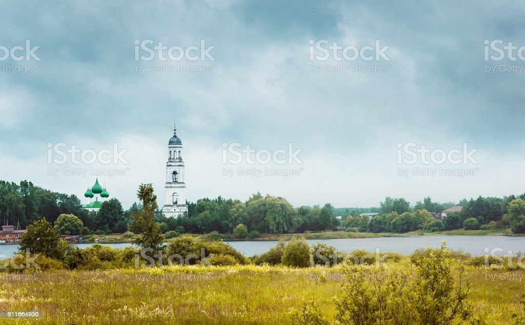 Russian landscape with an old church stock photo