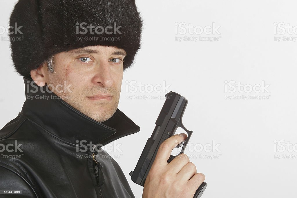 Russian Mafia Gangster In Fur Hat With Hand Gun Pistol stock photo
