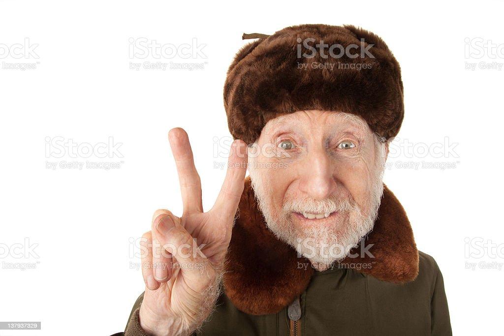 Russian Man in Fur Cap Making Peace Sign stock photo