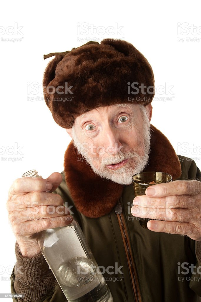 Russian Man in Fur Cap with Vodka stock photo