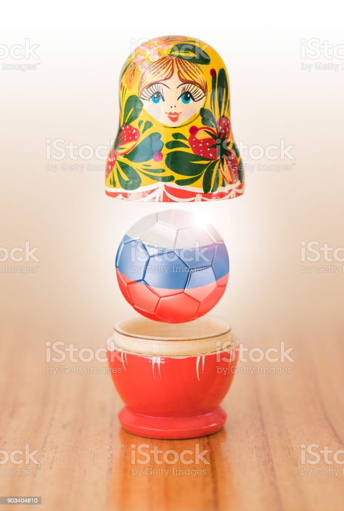 Russian matryoshka doll with russian soccer ball stock photo