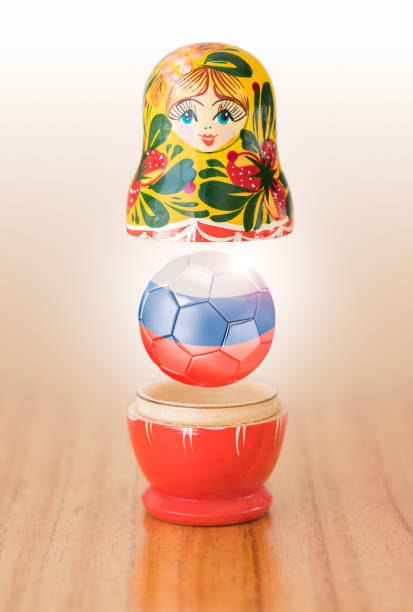 Russian matryoshka doll with russian soccer ball stock photo