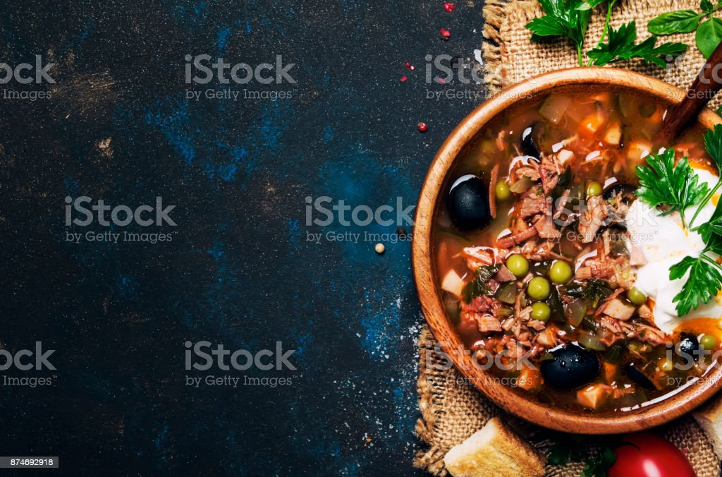 Russian Meat Solyanka Soup In Wooden Bowl stock photo