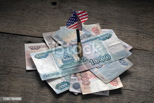 istock Russian money pierced by a dart arrow with an American flag 1090785986