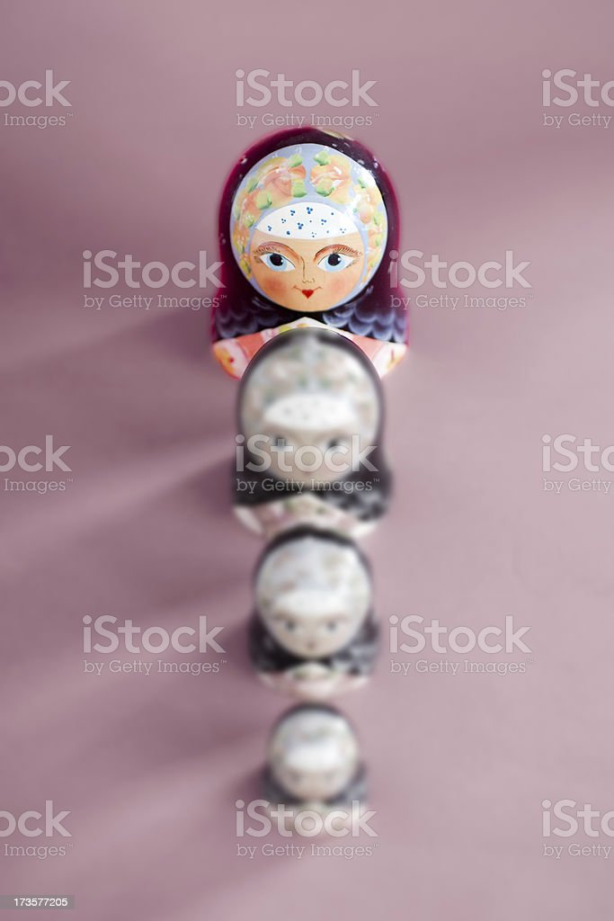 Russian nesting doll, standing out from the crowd stock photo