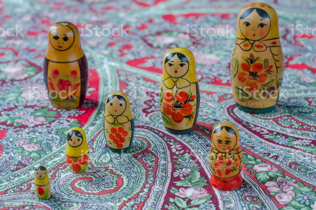 Russian nesting dolls on the traditional handkerchief. stock photo