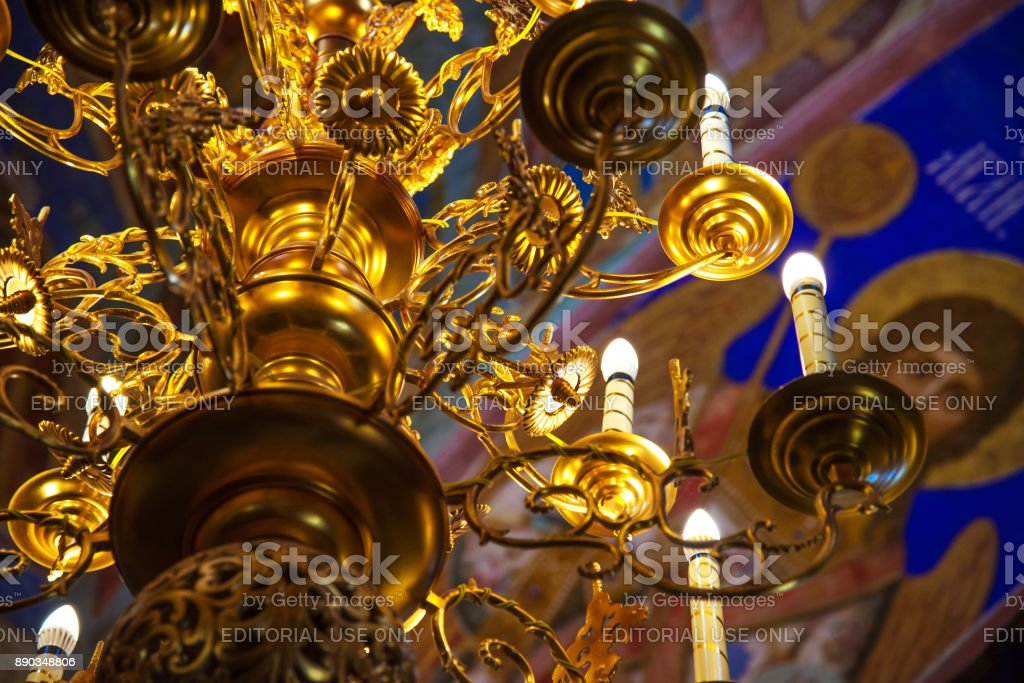 Russian orthodox church inside. Golden big chandelier close up and  religious frescoes as background  in Cathedral of Spaso-Efimiev monastery in Suzdal. The Gold Ring of Russia stock photo