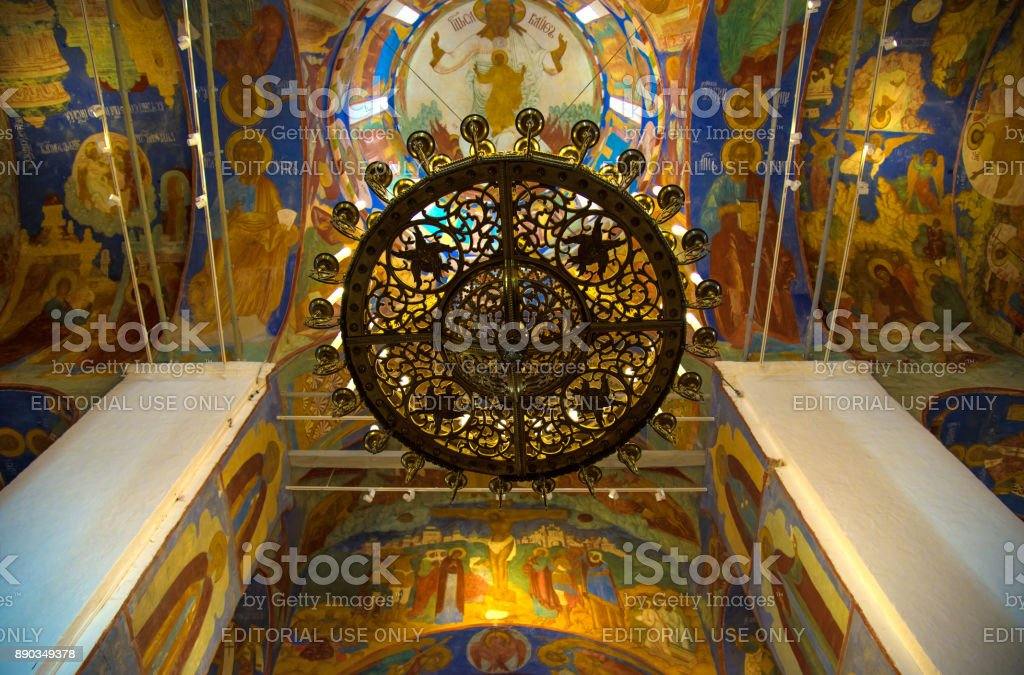 Russian orthodox church inside. Old big chandelier and  religious frescoes as background     in Cathedral of Spaso-Efimiev monastery in Suzdal. The Gold Ring of Russia stock photo