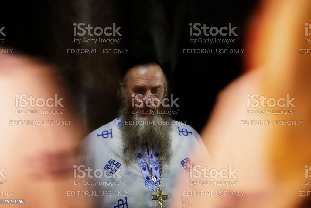 Russian Orthodox priest during mass stock photo