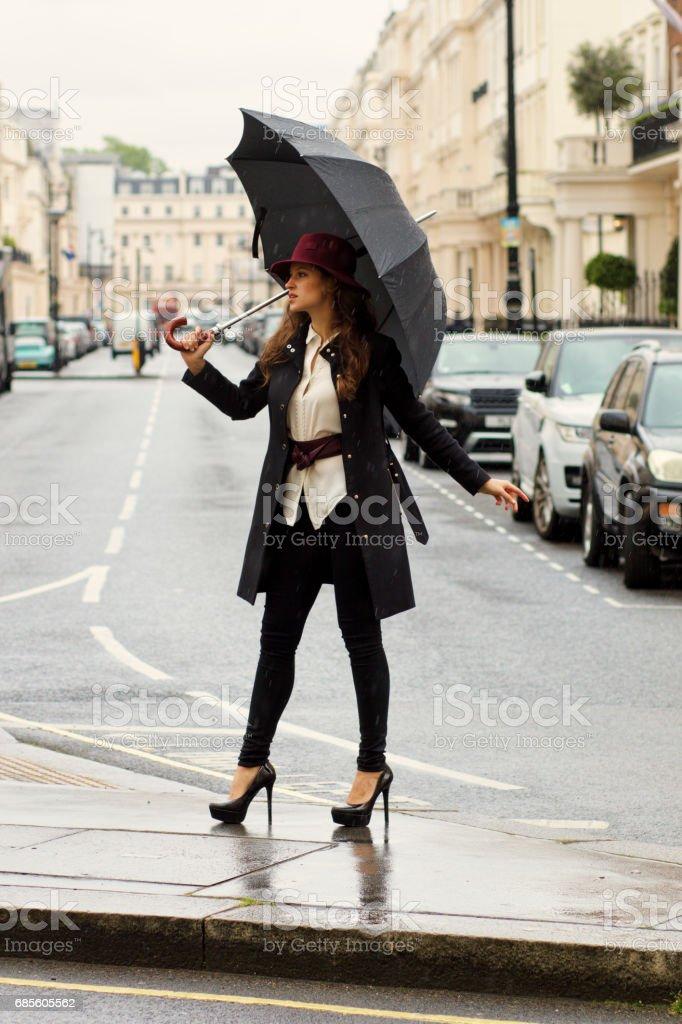 Russian outdoor girl fashion umbrella in Belgravia London stock photo
