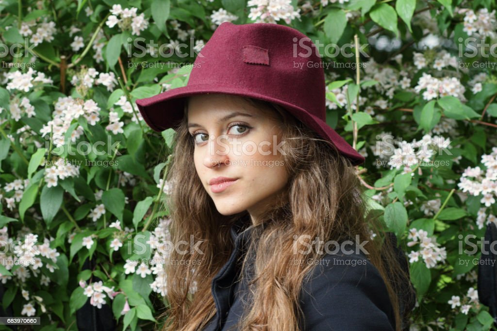 Russian outdoor girl felt hat fashion head and shoulders stock photo