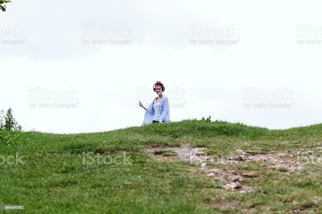 Russian Outdoor Girl Coming Over The Hill Mp3 Player Stock Photo