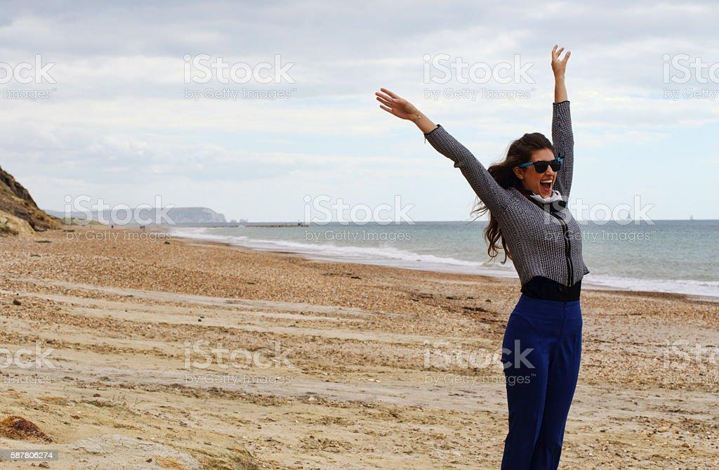 Russian outdoor girl morning beach exercise at Hengistbury Head stock photo