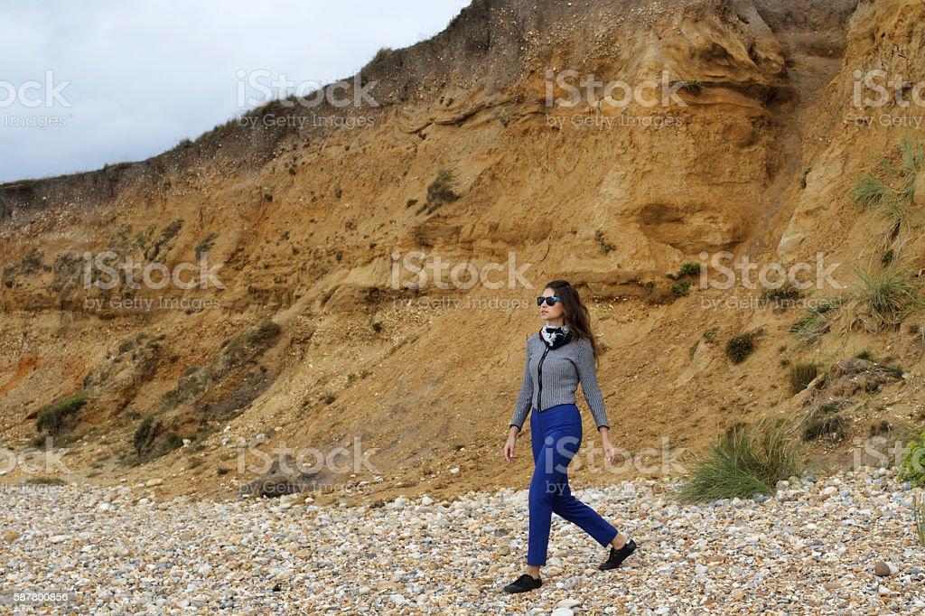 Russian outdoor girl on pebble beach at Hengistbury Head Dorset stock photo