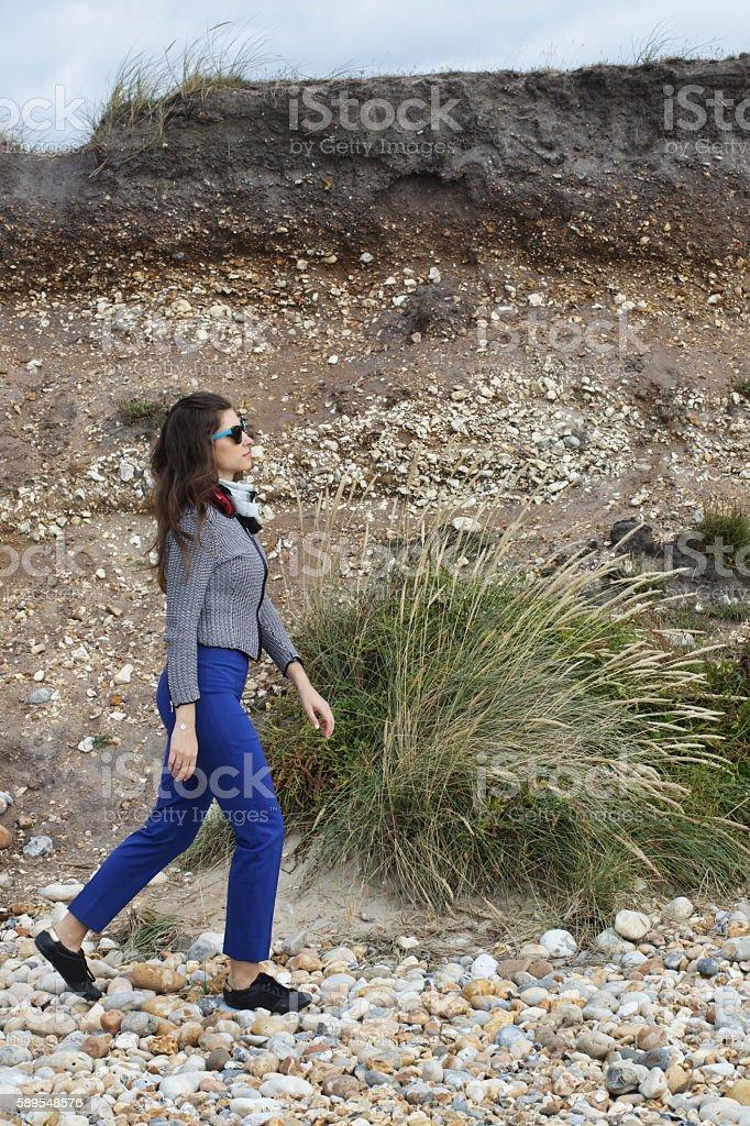 Russian outdoor girl walking at Hengistbury Head Dorset cliff background stock photo