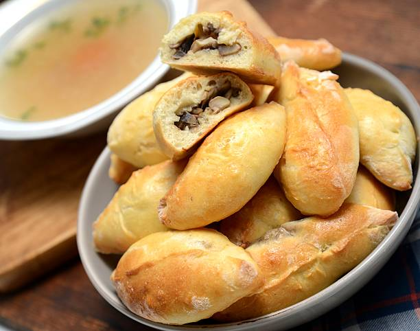 Russian Pirozhki and clear chicken  soup stock photo