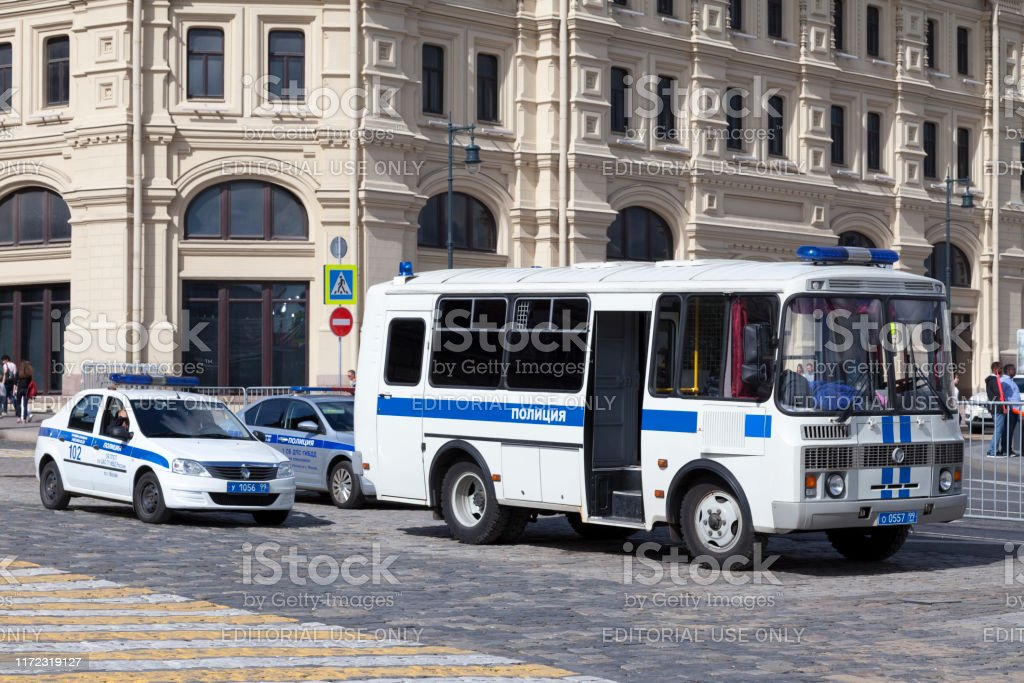 Russian police force Moscow, Russia - July 08 2018: A bus and two cars of police parked near the Bolshoi. Bus Stock Photo