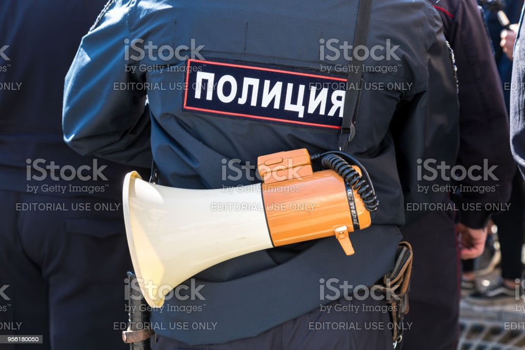 Russian policeman with megaphone speaker stock photo