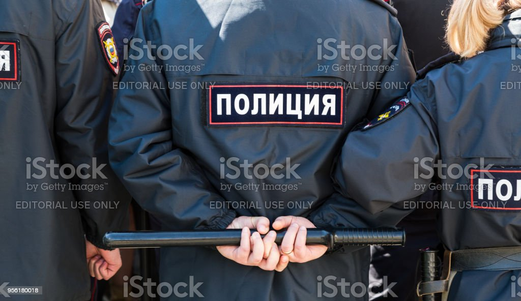 Russian policeman with police truncheon stock photo