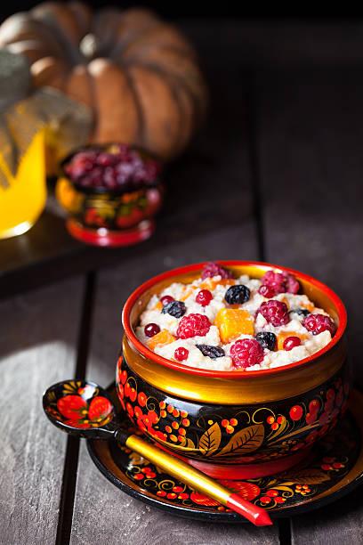 Russian porridge with pumpkin in hohloma dish stock photo