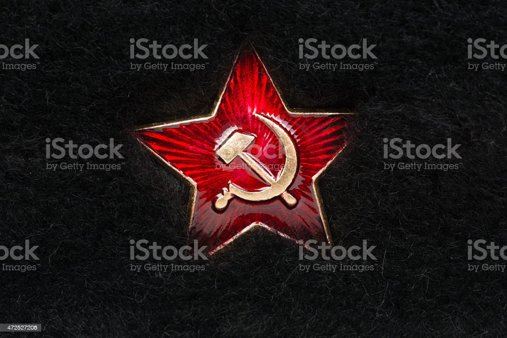 Russian Red Star with Hammer and Sickle on Fur stock photo