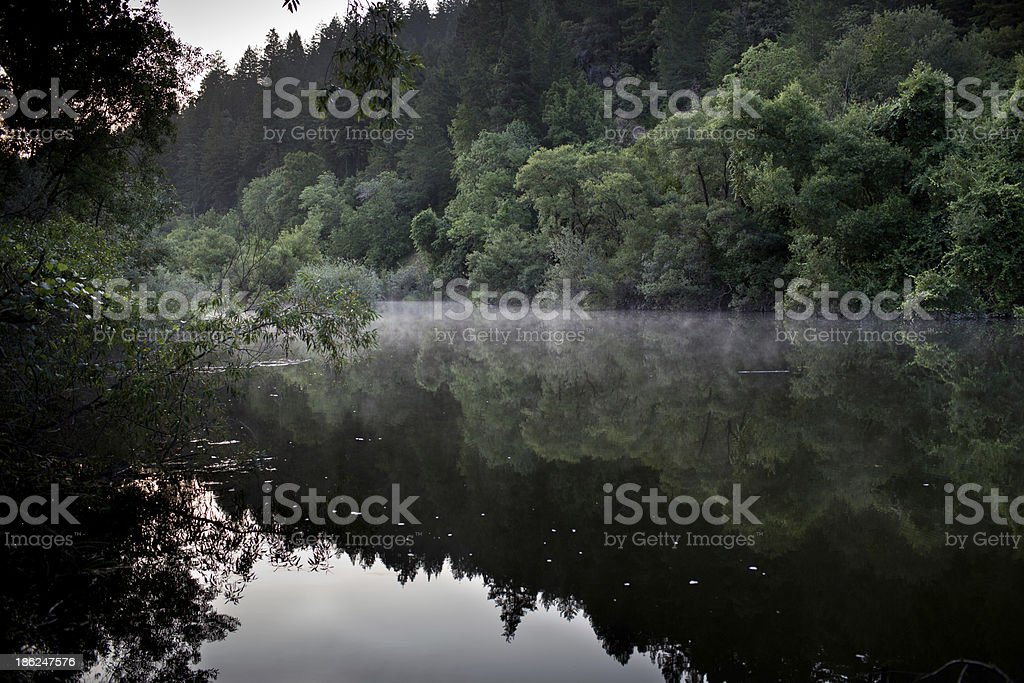 Russian river morning fog stock photo