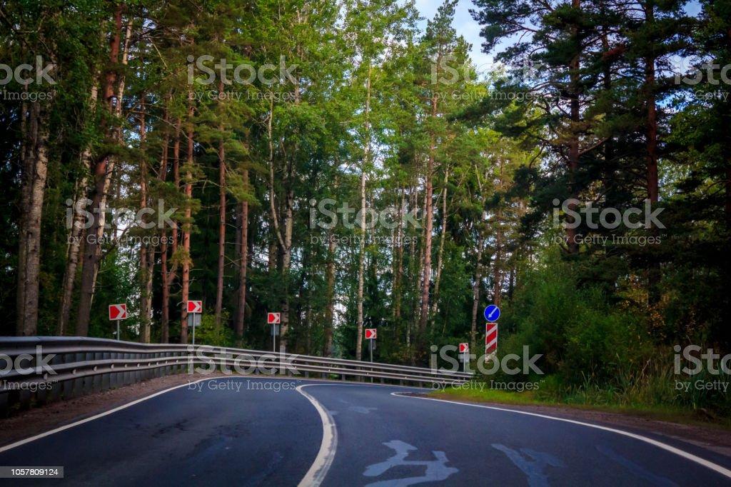 Russian roads in Karelia. Travel by road. Asphalt road. Smooth road...