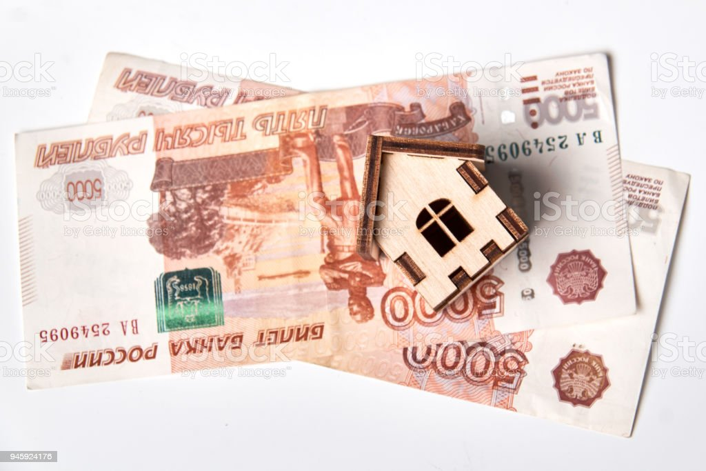 Russian rubles banknotes under house. stock photo