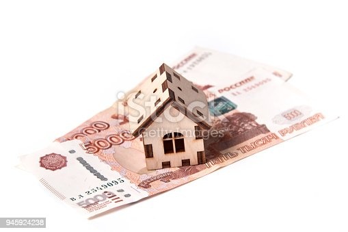 istock Russian rubles banknotes under house. 945924238