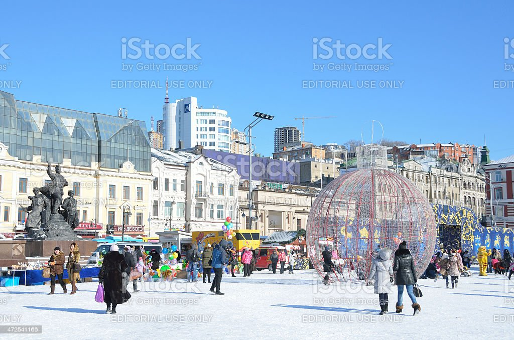 Russian scene: People walking on the square in Vladivostok stock photo