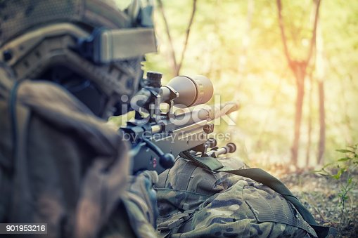 istock Russian sniper - rear view Sniper with rifle hidden in trench, stealth warrior, precise shoot, Infantry soldier shooting during military combat training. 901953216