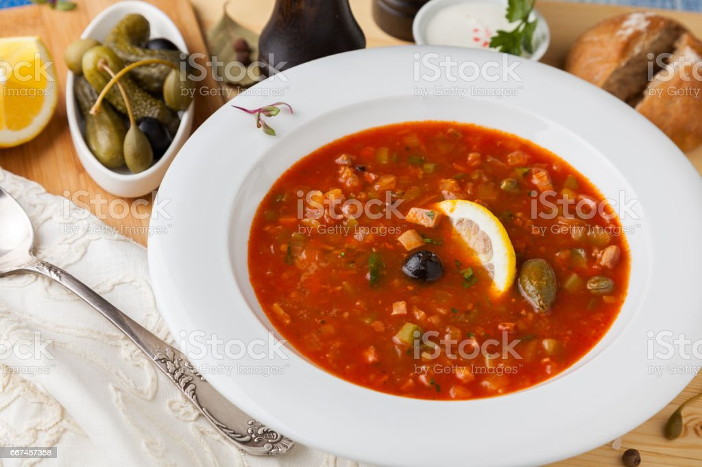Russian soup 'Solyanka' in a white plate stock photo