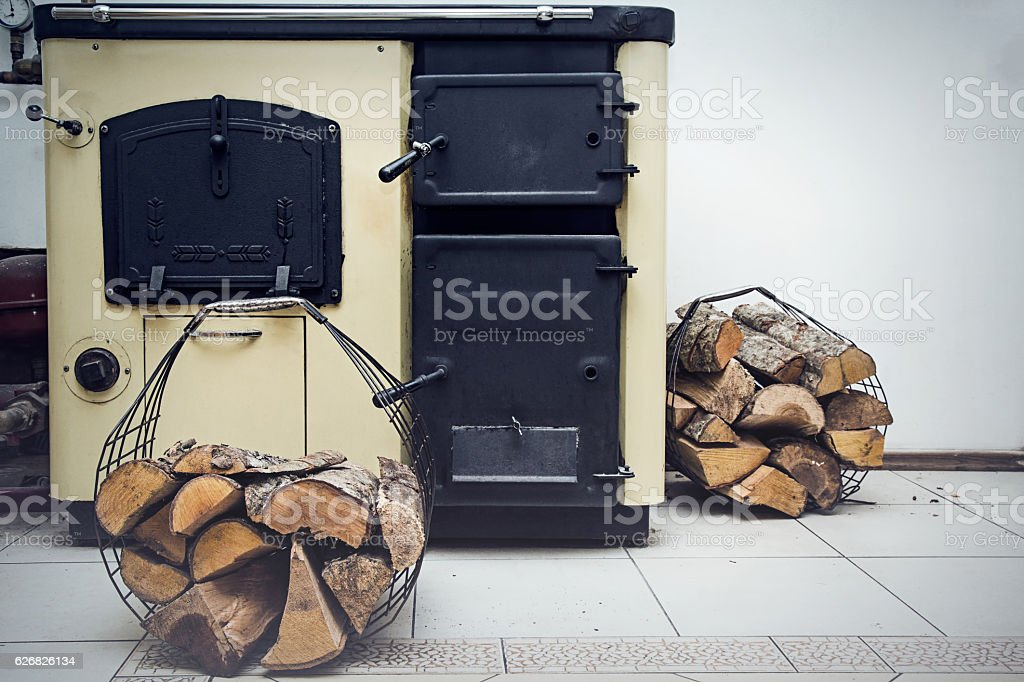 Russian stove with firewood baskets in the kitchen. stock photo