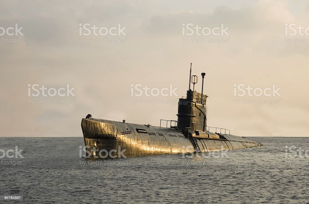 Russian submarine that's just barely above the surface stock photo