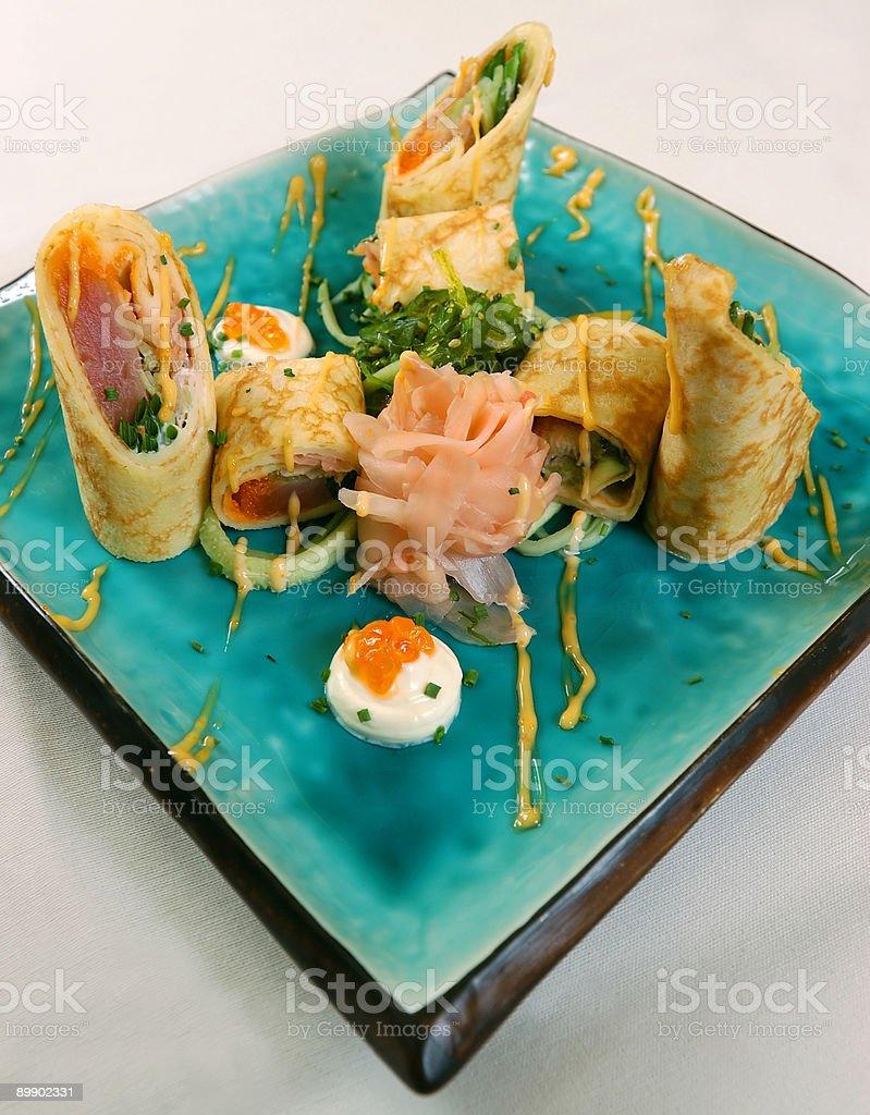 Russian sushi. Pan cake with fish royalty free stockfoto