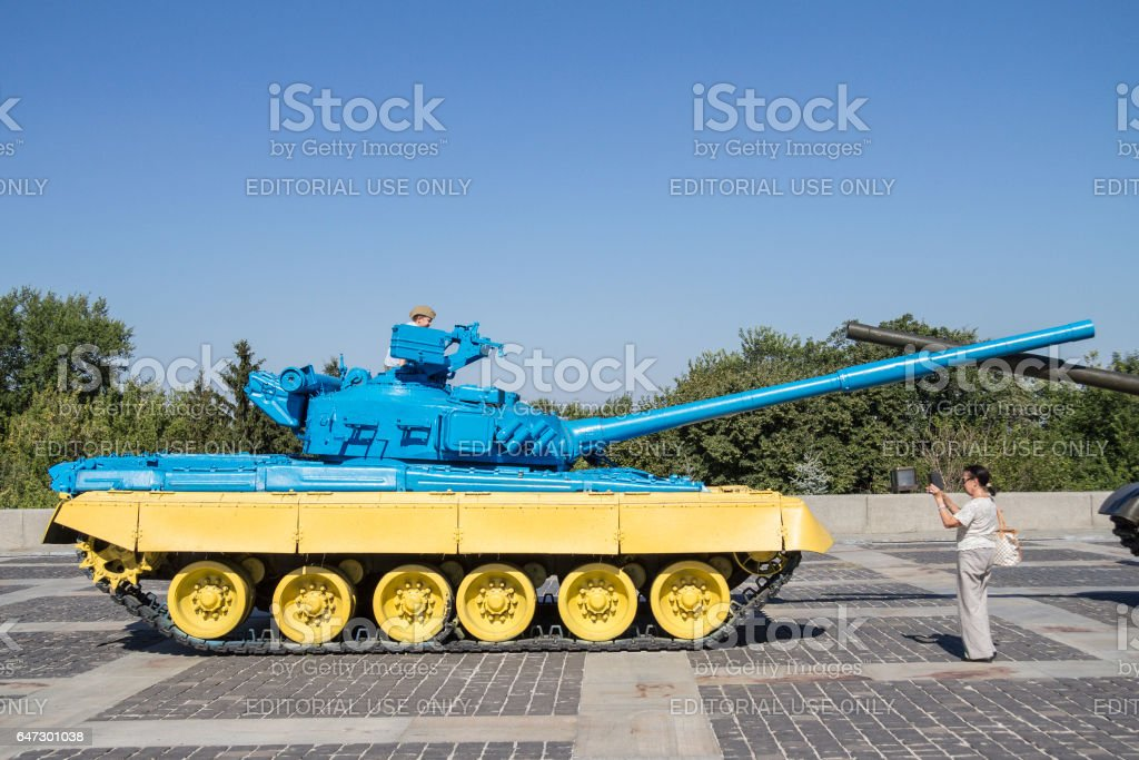 Kiev, Ukraine - August 9, 2015: Russian T55 tank captured in Eastern Ukraine by the Ukrainian army painted with the Ukrainian colors used as a trophy stock photo