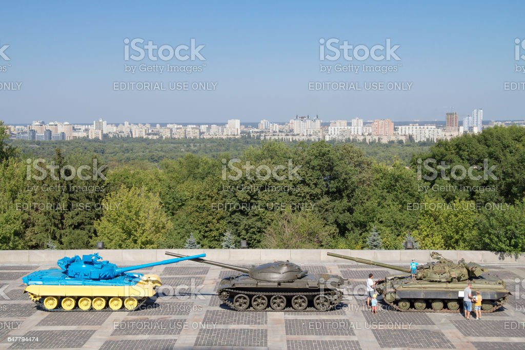 Kiev, Ukraine - August 9, 2015: Russian T55 tank captured in Eastern Ukraine by the Ukrainian army painted with the Ukrainian colors used as a trophy , Dnipro river can be seen in the background stock photo