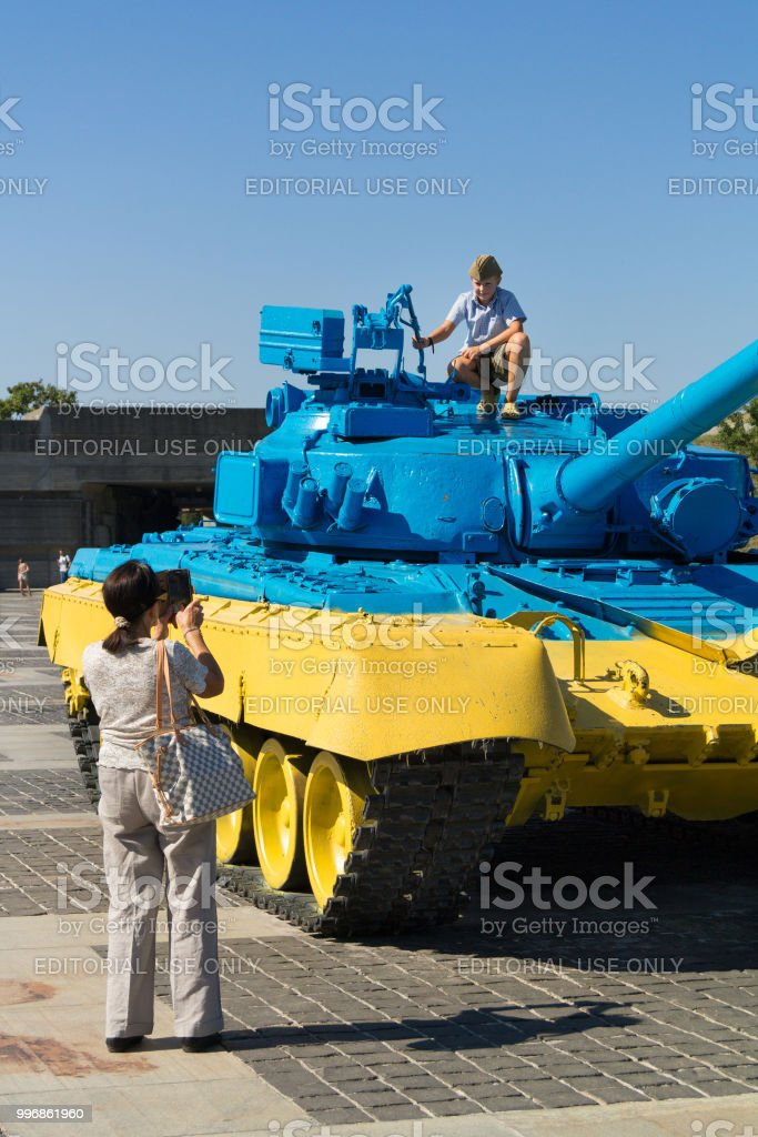 Russian T55 tank captured in Eastern Ukraine by the Ukrainian army painted with the Ukrainian colors used as a trophy stock photo