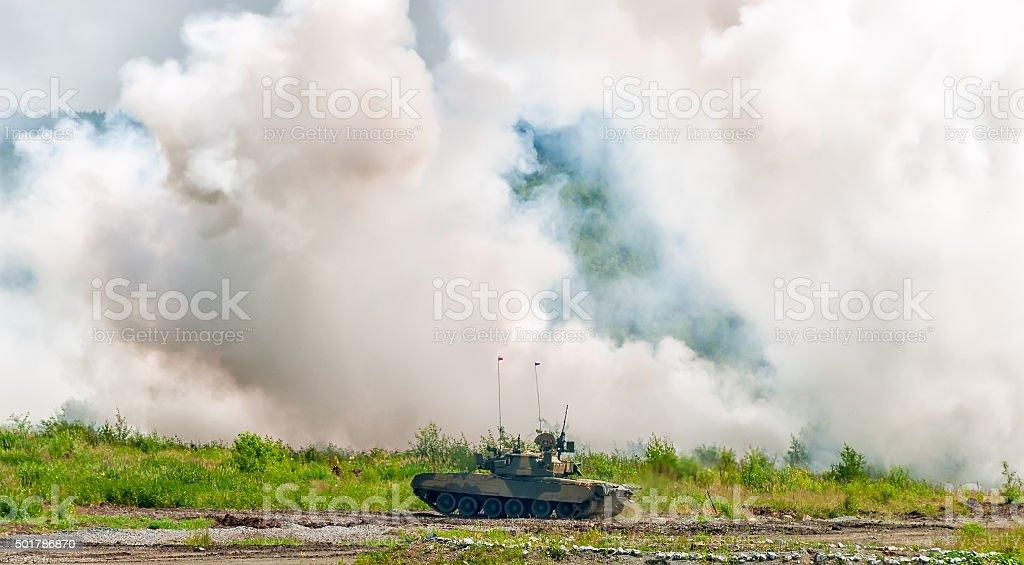 Russian tank T-80 making smoke screen from enemy stock photo