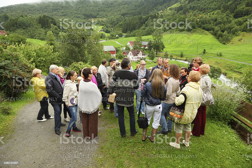 Russian tourists stand on hill and listen guide royalty-free stock photo